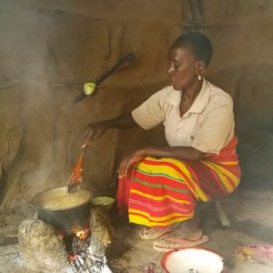 Cooking on an open fire in Masai kitchen | Wasabini