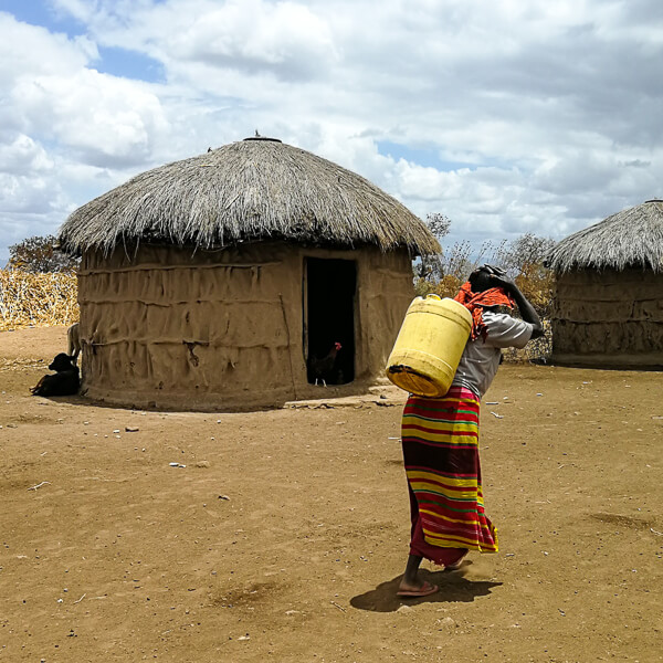 Masai woman carrying water | Wasabini